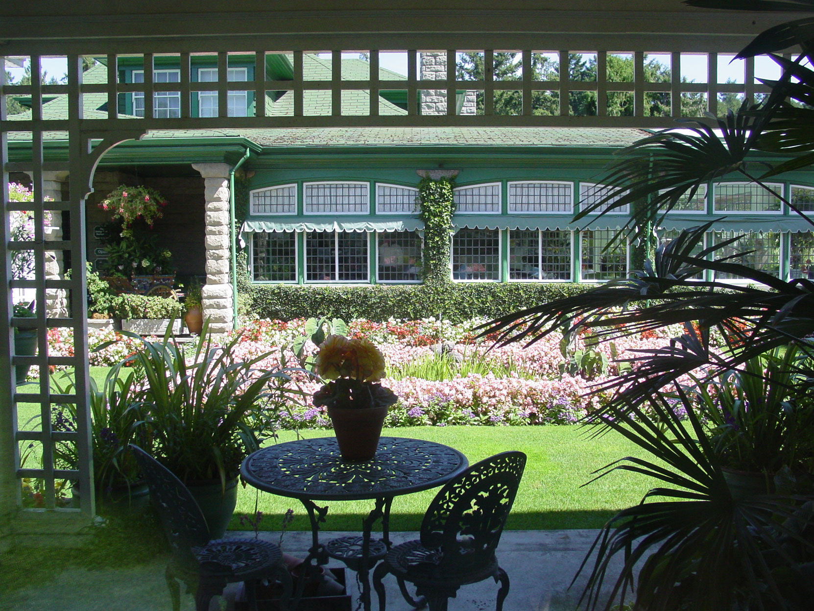 Jennie Butchart's Private Garden, designed and built in 1920-1921 by architect Samuel Maclure, looking toward the Sun Room, designed by Samuel Maclure in 1911 and extended by Samuel Maclure in 1919.This photo was taken from the Sun Room in August (photo by Author)
