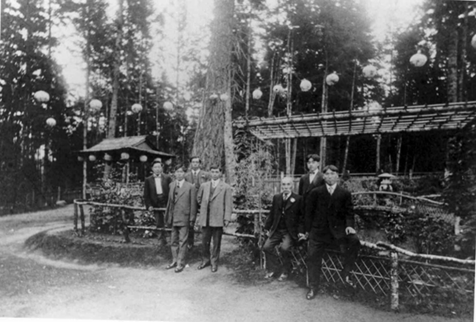 Isaburo Kishida (seated third from right) with his son Joe Kishida and his business partner Harry Takata, at the Japanese Tea Garden, Gorge Park, circa 1907 Photo: Esquimalt Archives)