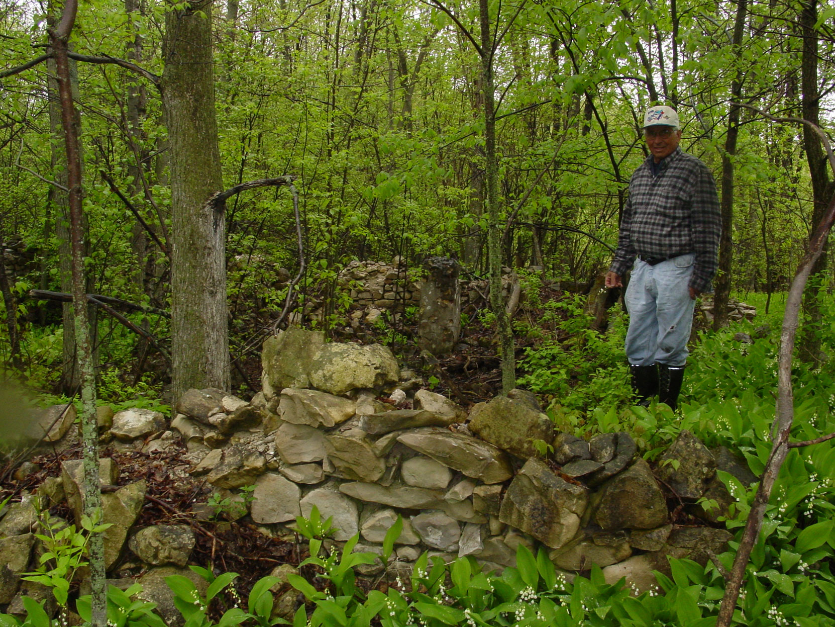 Landowner Murray Noble in what are believed to be the ruins of the Butchart's house at the Shallow Lkae factory site. Ruins of the Owen Sound Portland Cement Company factory, Shallow Lake, Ontario, 2003. (photo by author)