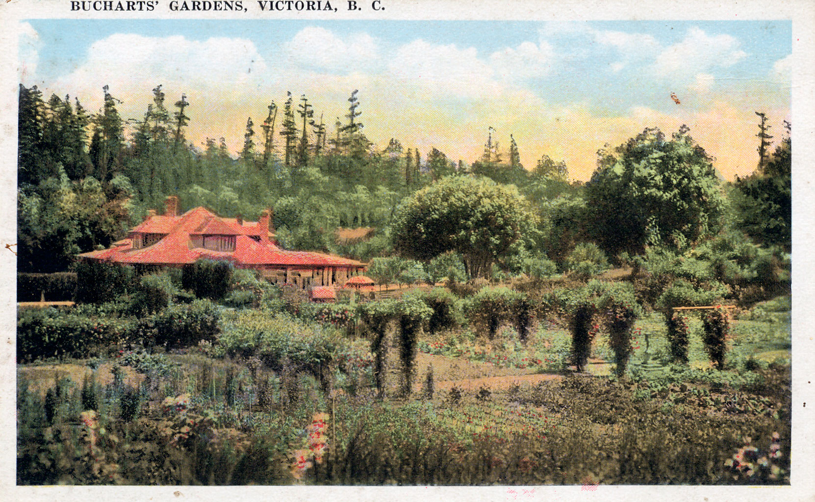 "Postcard showing Benvenuto, viewed from the west, circa 1919-1920, prior to the construction of the Private Garden in 1921 and the Rose Garden in 1929. The foreground shows the ""Kitchen Garden"" which is now the site of the Rose garden. (Author's collection)"