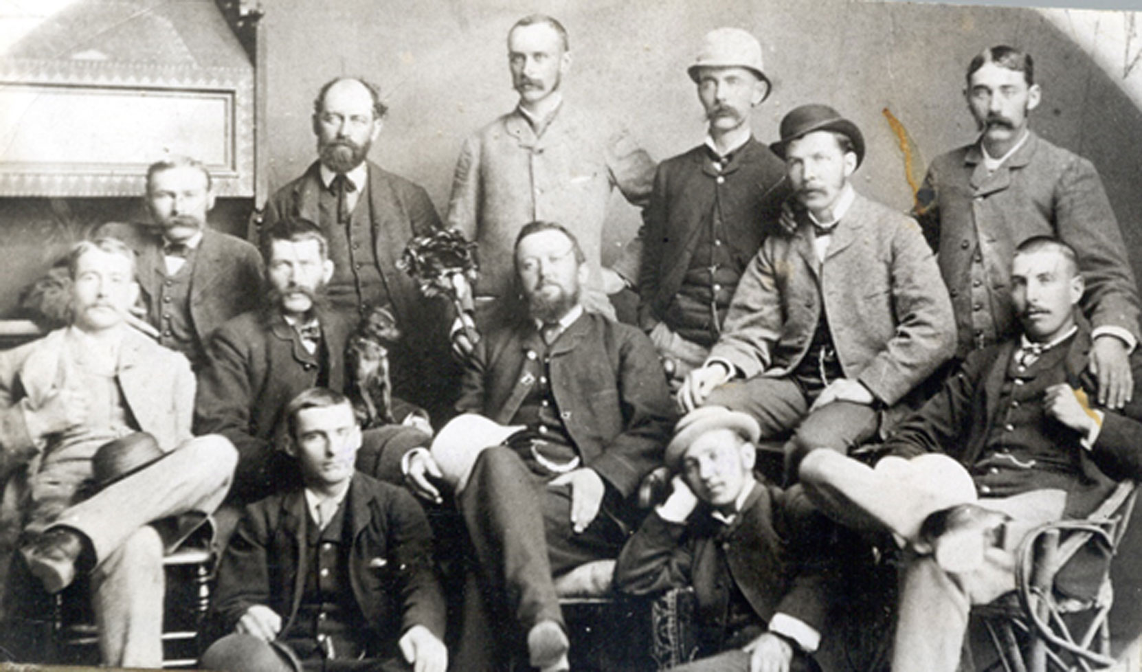 The Owen Sound Board of Trade, circa 1880. Robert Butchart, aged 23, is standing at the extreme right. Standing (left to right): Charles Conklin, Mr. Coates, William Masson, W.B. Stephens, Robert Pim Butchart. Seated (left to right): J.R.Brown, George S. Kilbourn, George I. Inglis, William Brown, Joseph Maughn. Seated on floor (left to right): unidentified, John C. Crane George S. Kilbourn bought shares of the Owen Sound Portland Cement Company in 1895 and remained a shareholder until the company was sold in 1909. Kilbourn also served as the company's Secretary and Treasurer from 1895 to 1909.) William Masson owned 2 shares of the Owen Sound Portland Cement Company from 1892 to 1896) (photo: Grey Roots Museum and Archives)