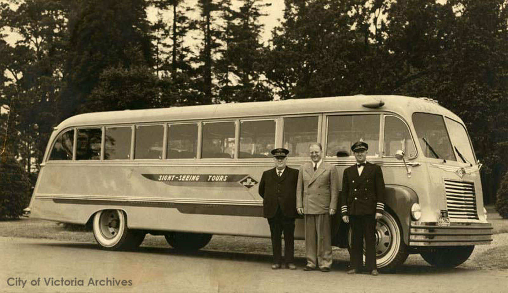 "George ""Rebel"" Mowat (right) with the first converted sightseeing bus received by Gray Line of Victoria, 1940. The other two men in photograph are Angus ""Winnipeg"" Chilton, Harold Husband (photo: City of Victoria Archives)"