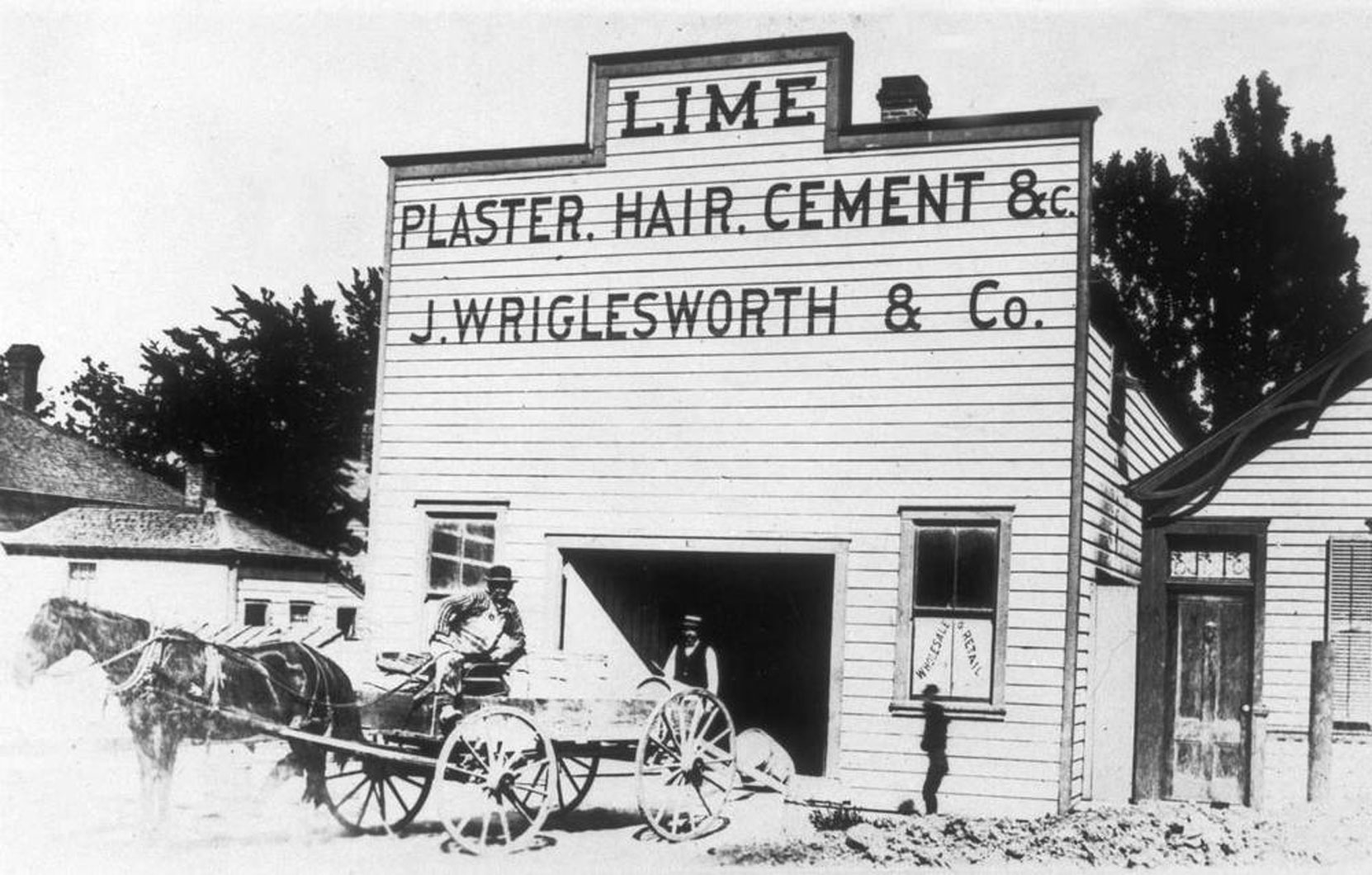 Joseph Wriglesworth & Co., Lime Dealers, on the south east corner of Yates Street and Blanshard Street in downtown Victoria, circa 1887 (BC Archives photo A-03469)