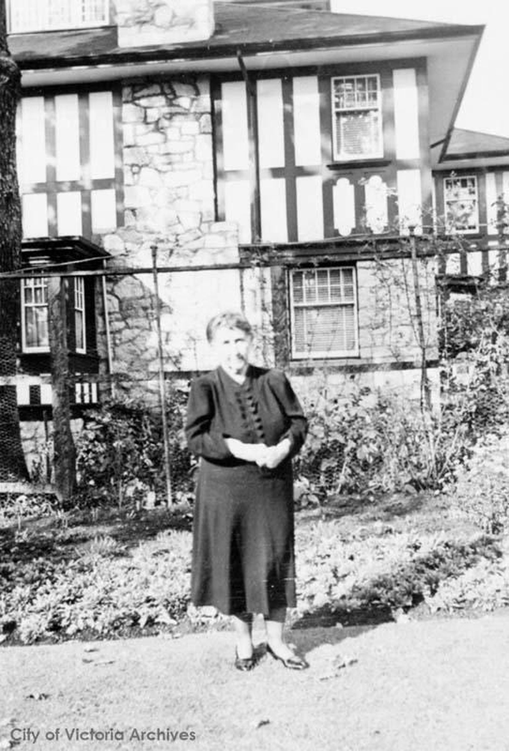 Jennie Butchart, circa 1940. The house is possibly 906 St. Charles Street in Victoria's Rockland district, where Robert and Jennie Butchart moved circa 1939-1940. (City of Victoria Archives photo M00449)