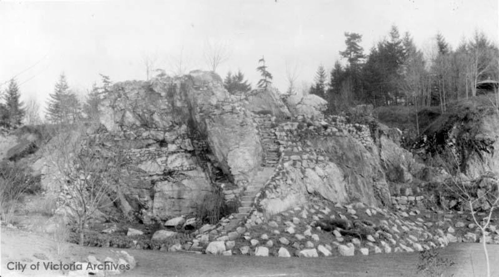 The Mound from the west side of the Sunken Garden, circa 1910. This section of the Sunken Garden was designed by Raoul Robillard. (City of Victoria Archives photo M05820)