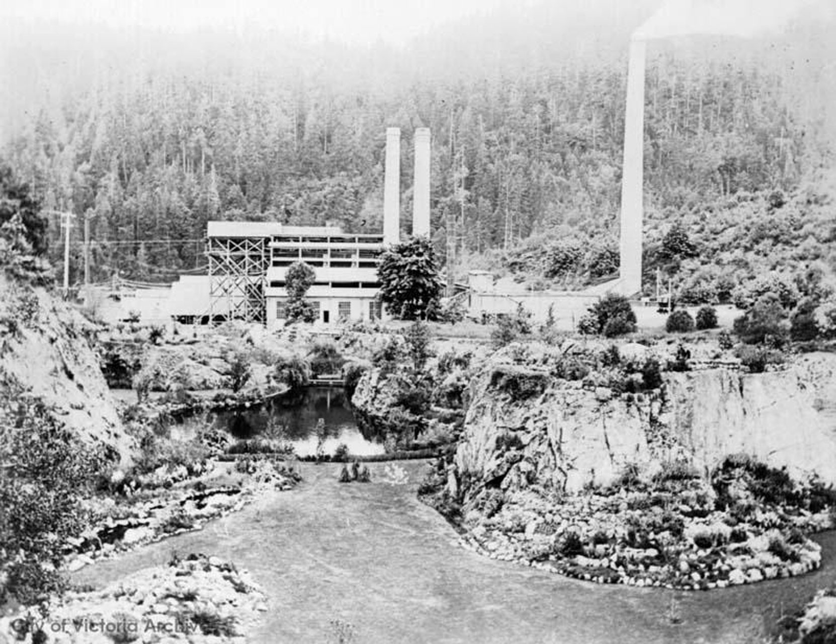 The Vancouver Portland Cement Company plant above the Sunken Garden and the Trout Pond, circa 1910 (City of Victoria Archives photo M00805)